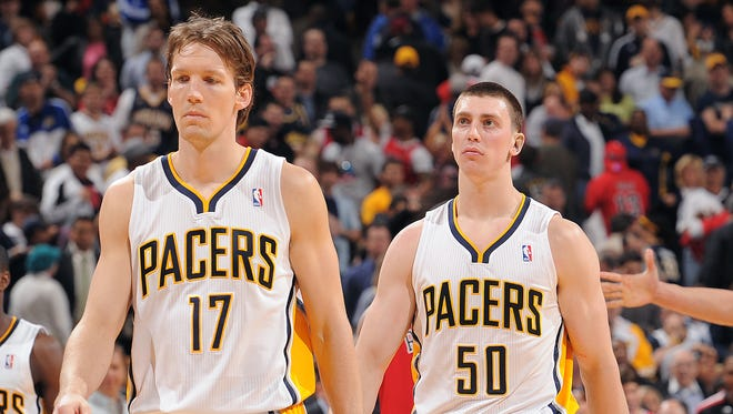 FILE - Former Indiana Pacers Mike Dunleavy (17), Tyler Hansbrough, right, in 2011.