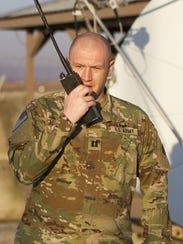 Captain McQueary using the radio.