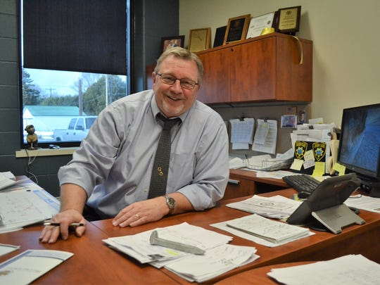 Oconto County Sheriff Mike Jansen, seen in his office on Friday, has announced he will not seek re-election this year, wrapping up a 41-year career in law enforcement.