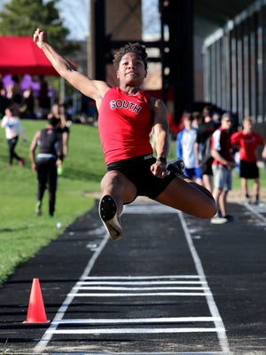 Waukesha' South's Armoni Brown competes in the finals of the girls long jump during the Myrhum track and field invitational at Arrowhead High School.
