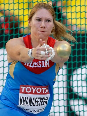 Russia's Gulfiya Khanafeyeva competes in the the women's hammer throw final at the World Athletics Championships in the Luzhniki stadium in Moscow, Russia.