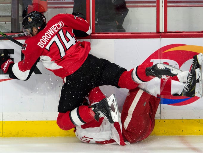 Ottawa Senators' defenseman Mark Borowiecki collides
