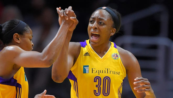 Los Angeles Sparks  forward Nneka Ogwumike, right, was named the WNBA's MVP.