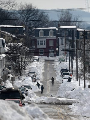 Ridge Avenue in York, like many in the city, became a one-lane road after crews plowed a portion of it following the weekend's storm, which dropped about 30 inches of snow.