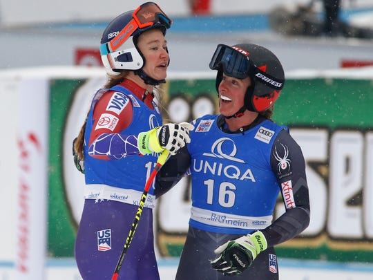 United States' Laurenne Ross, left, and Stacey Cook smile in the finish area after completing an alpine ski, women's World Cup downhill in Bad Kleinkirchheim, Austria, Sunday, Jan. 14, 2018.