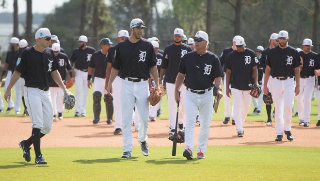 The Tigers walk to their next drill during spring training on Tuesday in Lakeland, Fla.