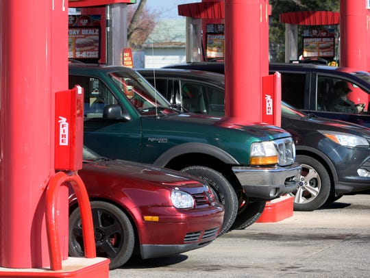 Cars jam the pumps before holiday travel at the Sheetz