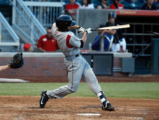Isotopes third baseman Derrick Gibson takes a swing