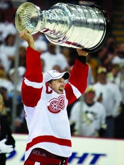 Nicklas Lidstrom holds the Stanley Cup after defeating the Penguins in Game 6 of the Stanley Cup finals June 4, 2008 in Pittsburgh.