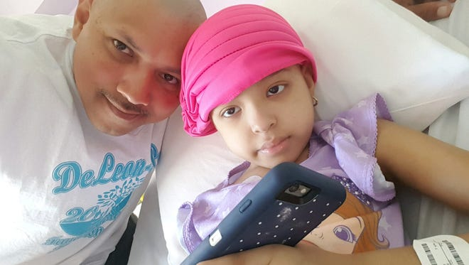 Porfirio De Leon, 40, is a former Tallahassee resident whose home was flooded during Hurricane Harvey. He, his daughter Mia who had leukemia, and the rest of his family are staying temporarily with his sister.