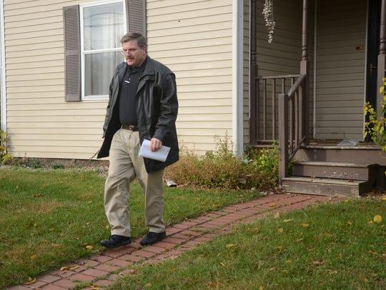 Deputy Ron Alberty leaves a home on Jordan Street.