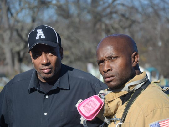 Rev. Sheldon Williams talks with Battle Creek Fire