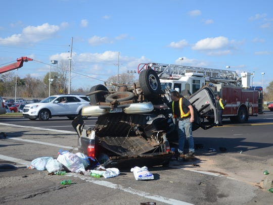Crews remove one of the vehicles after the accident