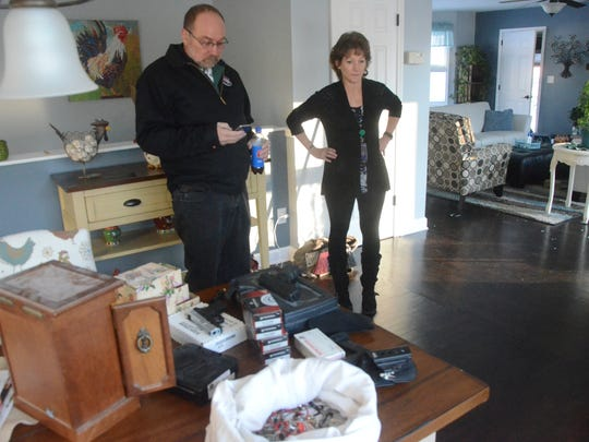 Robin and Wendy Terpening look over some of the items a burglar gathered after entering their Battle Creek home early Wednesday.