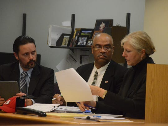 Maurice Barnes with his attorneys, Justin McCarthy and Leslie Kranenberg.