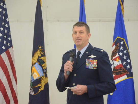 Colonel Ronald Wilson speaks to base personnel.