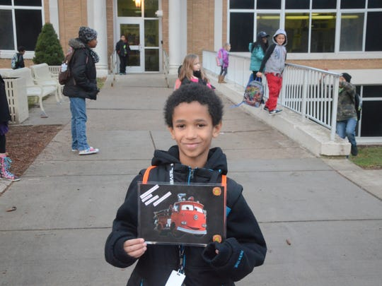 Tayshaun Twigg-Jackson had a card as a memento of his ride to Fremont School on a fire truck.