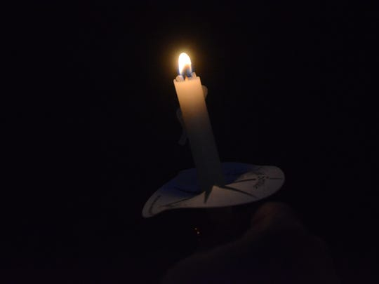 Candles gave some light at the vigil.