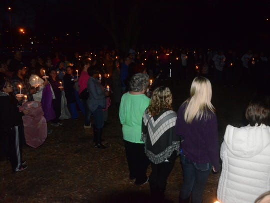 About 150 people attended a vigil Saturday at Irving