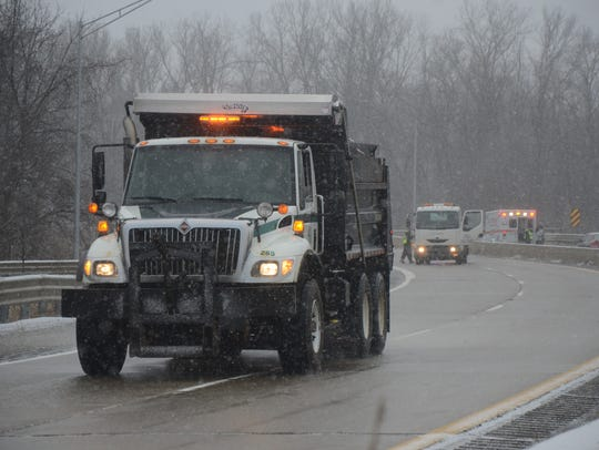 Battle Creek salt truck makes a pass on M-66 between