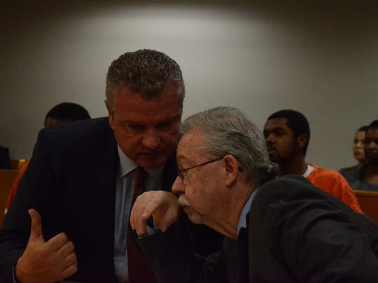 Attorneys Donald Sappanos, left and Patrick O'Connell confer during Friday's preliminary exam.