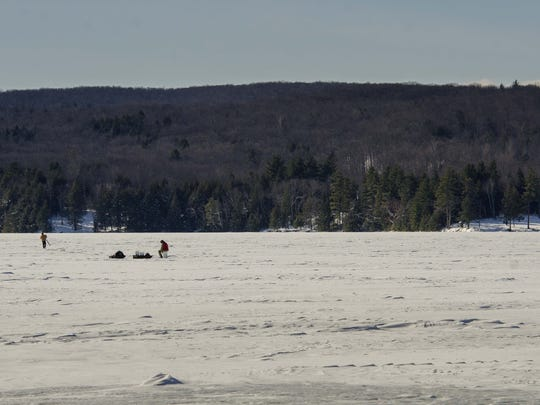 Developer Travis Belisle is proposing to erect 7 nearly-500 foot high wind turbines on this hill in Swanton, seen from Fairfield Pond on Friday, January 22, 2016.
