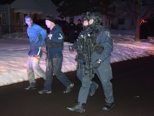 Battle Creek officers escort the unidentified 21-year-old