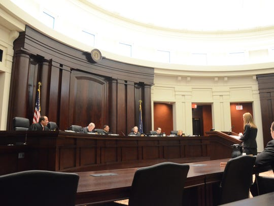 Jennifer Clark argues before the six justices of the