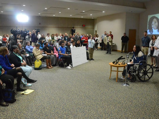 Tiana Carruthers speaks for friends, family, Borgess employees and reporters Thursday.