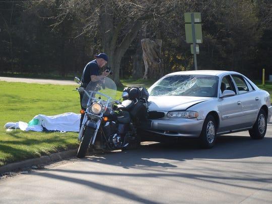Battle Creek Crime Technician Todd Rathjen  photographs