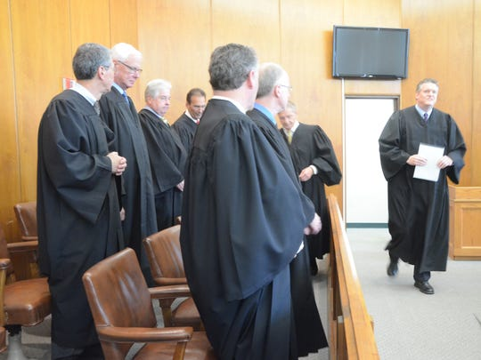 Chief Judge Mike Jaconette enters to begin the investiture.