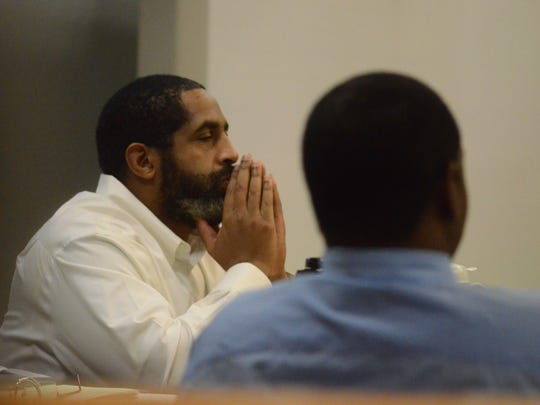Robert Williams, left, and Ricahrd Young listen to