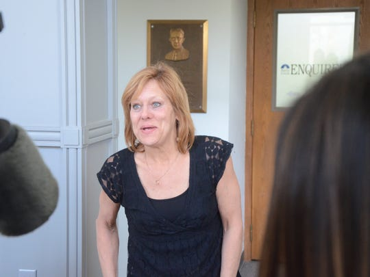 Lorinda Swain meets reporters after the Michigan Supreme