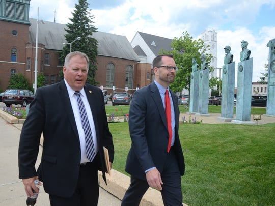 Kalamazoo County Prosecutor Jeff Getting, left, and Assistant Prosecutor Jeff Williams prepare to meet with reporters outside the courthouse Monday.