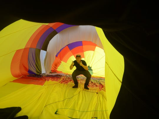 Joe Zvada celebrates a bit inside his balloon envelope after winning the 2015 Field of Flight. He returns this year to defend his championship.