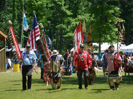 Native American Veterans led by Head Veteran Dale Anderson, right, begin the Grand Entry.