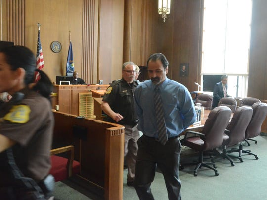 Troy Estree is taken from the courtroom after his sentencing