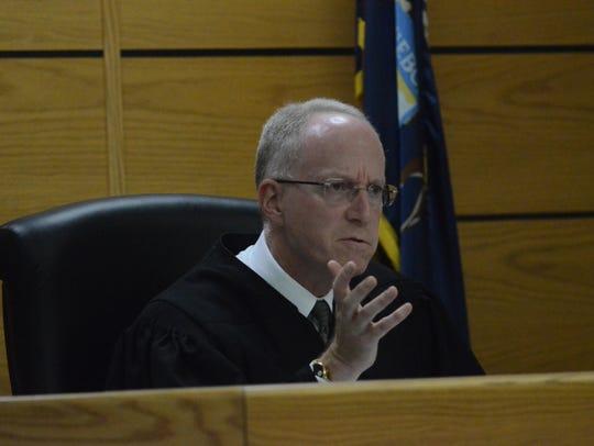 Calhoun County Circuit Judge John Hallacy delivers