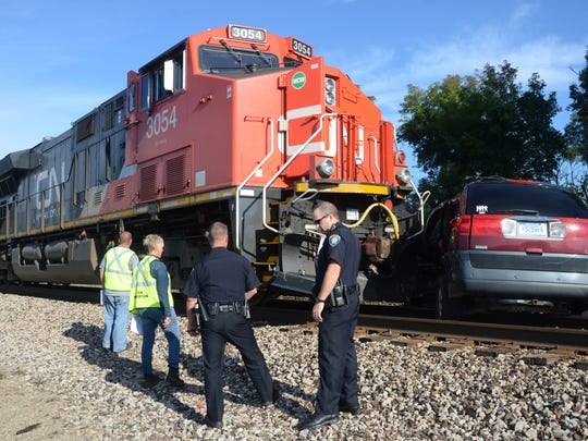 A Portage man escaped serious injury when his SUV collided with a train in Battle Creek Thursday.