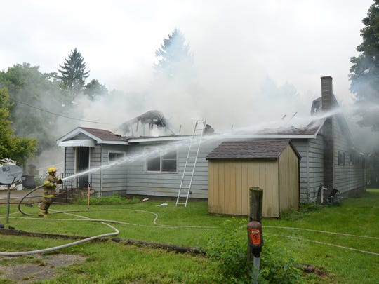 Five fire departments responded to a fire on 2-Mile Road for a house fire Thursday.