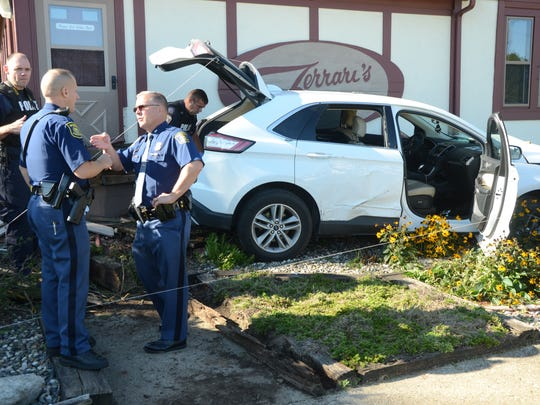 Michigan State Police Lt. James Coleman, right, and Trooper Tim Lane pursued the driver and two passengers of a car which crashed in Emmett Township Friday.