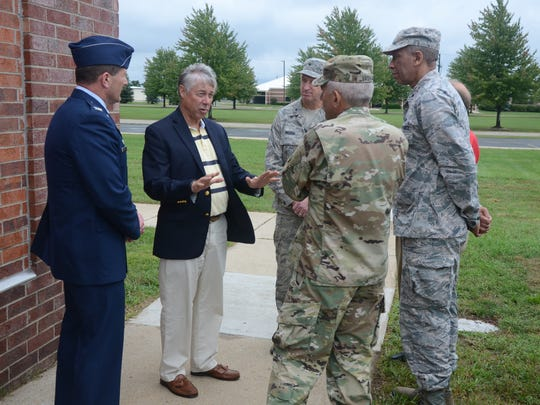 Congressman Fred Upton  talks with Colonel Bryan Teff, from left, base commander, Brigadier General Ronald Wilson, former base commander, Major General Leonard Isabelle, commander of the Michigan Air National Guard and Major General Gregory Vadnais, Adjutant General of the Michigan National Guard.