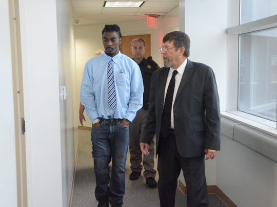 Christian Logan, left, with his attorney, James Sauber, enter the courtroom to begin the trial.