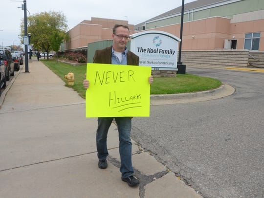 Marty Herr, 47, of Jackson was the only person to picket the Chelsea Clinton rally.