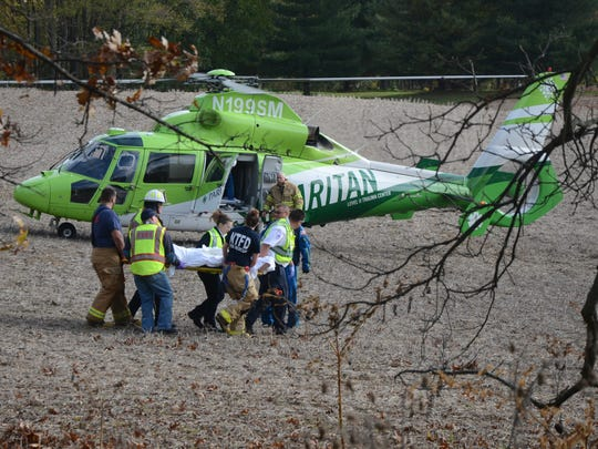 Emergency workers take one of three Union City students to a medical helicopter after a Monday traffic crash.