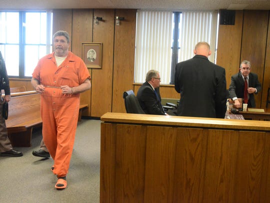 Charles Pickett Jr. leaves the courtroom during a break