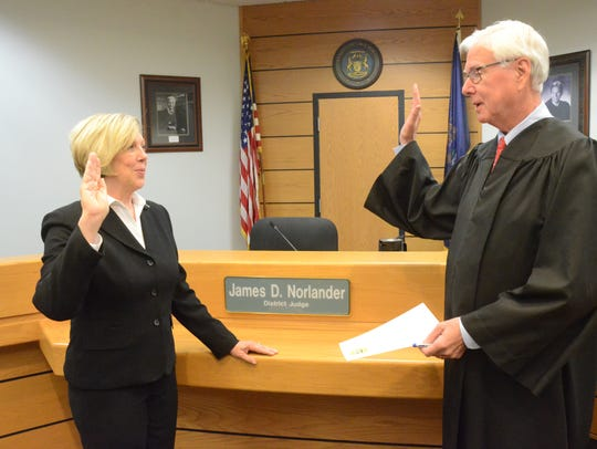 Judge James Norlander administers oath to his wife