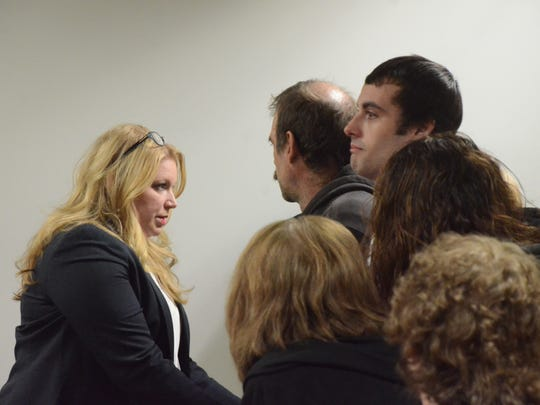 Defense attorney Kymberly Schroder talks with the Ball family after the verdict.