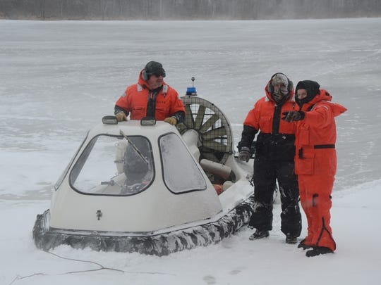 Detective Bryan Gandy, from left, Deputy Dave Winder and Ron Treadwell of the Calhoun County dive team prepare to search the lake.