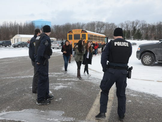 Battle Creek officers watch as students from Lakeview
